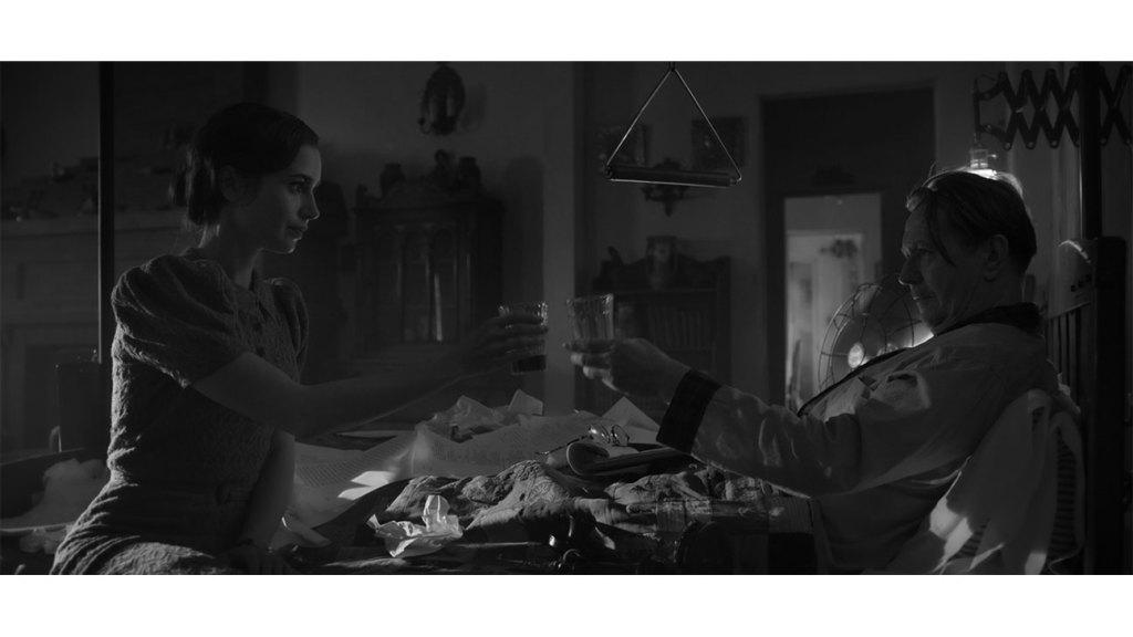 Lily Collins as Rita Alexander, Gary Oldman as Herman J. Mankiewicz