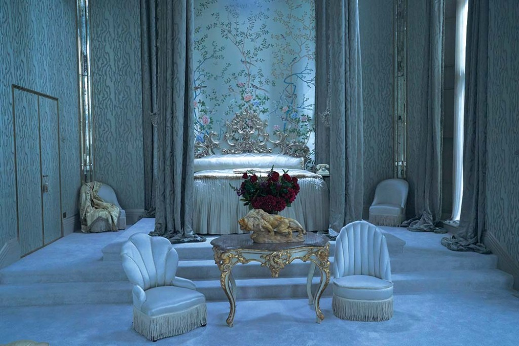 The production designer chose a de Gournay chinoiserie scenic wallpaper for the blue- and gray-toned bedroom that serves as a sort of mausoleum for the late Rebecca.