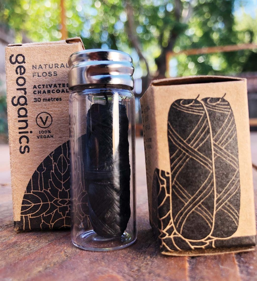 Compostable Dental Floss, Georganic's corn-based plastic floss with activated charcoal powder and peppermint oil and refillable glass container; $7, prostainable.com