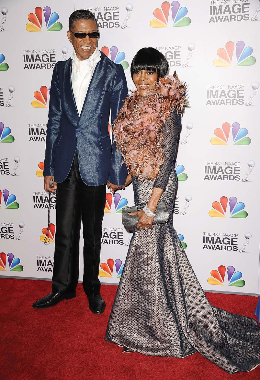 The actress, with the designer, wearing his mermaid strapless gown and bolero with feather collar at the 2012 NAACP Image Awards.