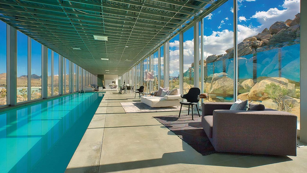 Now listed on Airbnb for $2,661 a night, the Invisible House includes a 100-foot indoor pool. The design was inspired by Mies van der Rohe skyscrapers and the monoliths of Stanley Kubrick movies.