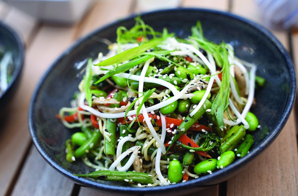 Noodle bowl with edamame, broccolini and sesame soy dressing.