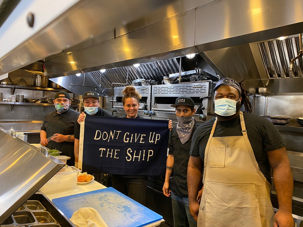 L.A.-based chef Antonia Lofaso (Venice's Scopa Italian Roots; DTLA's Dama) and staff prepare takeout orders, as seen in the Food Network doc Restaurant Hustle 2020: All on the Line.
