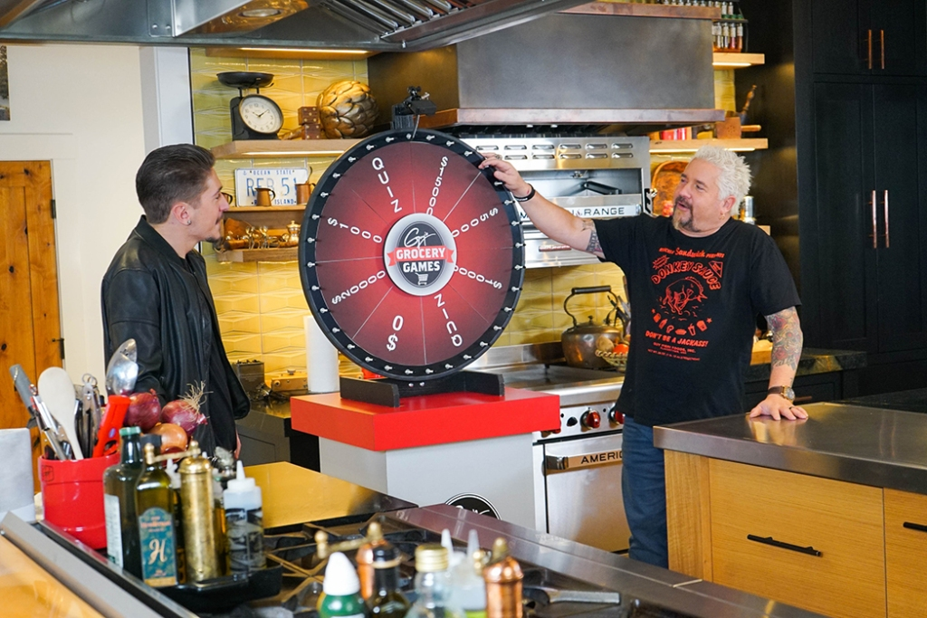 Guy Fieri (right) his son Hunter in a 2021 episode of Food Network's Guy's Grocery Games Delivery Edition, shot from home.