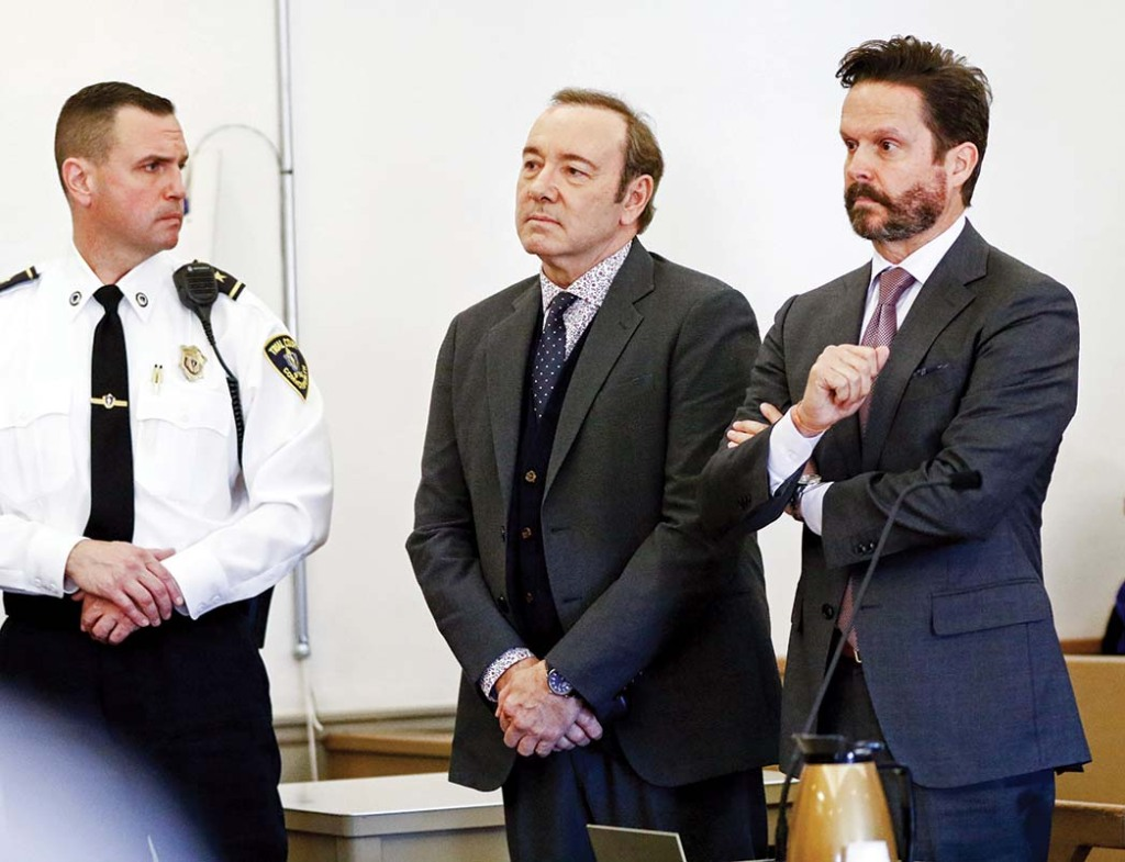 Kevin Spacey (center, with lawyer Alan Jackson) at his arraignment on sexual assault charges at Nantucket District Court in 2019.