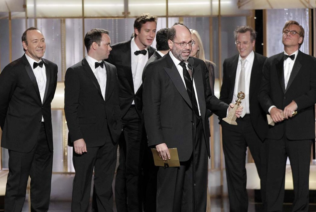 Rudin (center) with the Golden Globe for best picture for The Social Network in 2011.