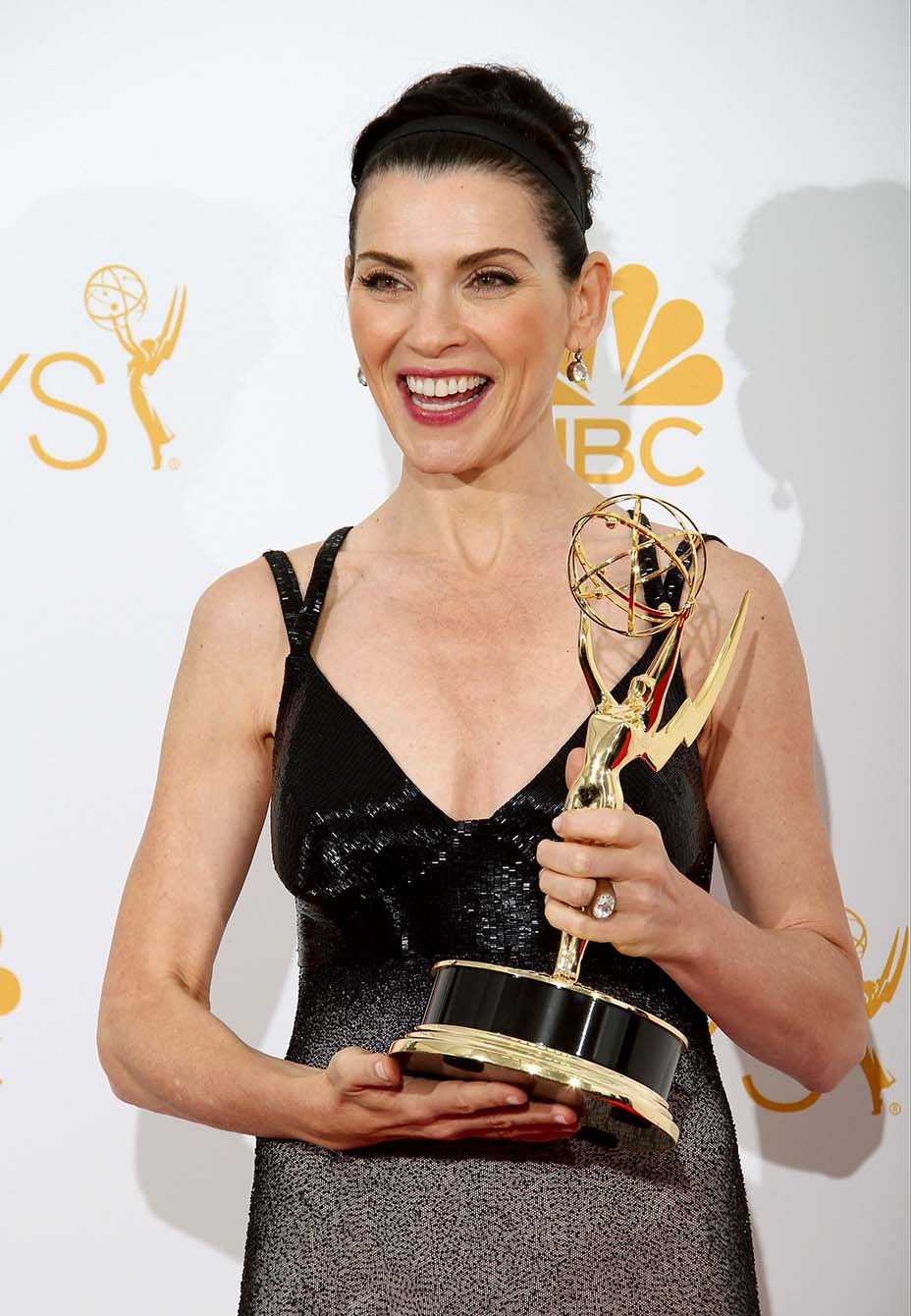 Julianna Margulies poses in the photo room with her award for Outstanding Lead Actress in a Drama Series for 'The Good Wife' at Nokia Theatre L.A. Live on August 25, 2014 in Los Angeles, California.