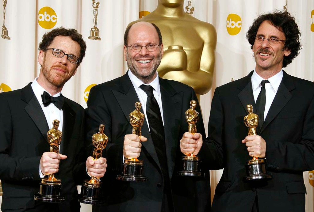 Rudin in 2008 flanked by Ethan (left) and Joel Coen, best picture Oscar winners for No Country for Old Men.