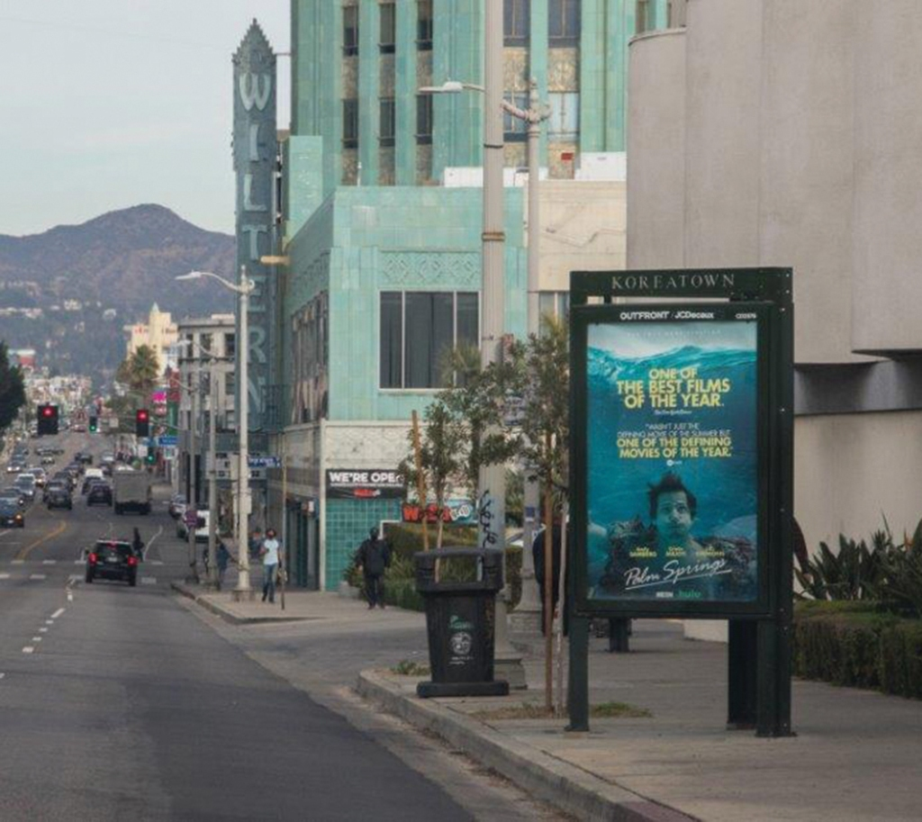 bus stop ad for the film Palm Springs