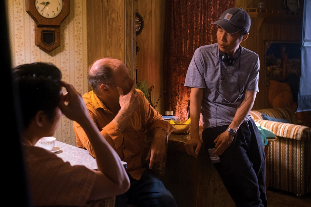 Isaac Chung on set with (foreground) Steven Yeun and Will Patton, who plays a religious neighbor.