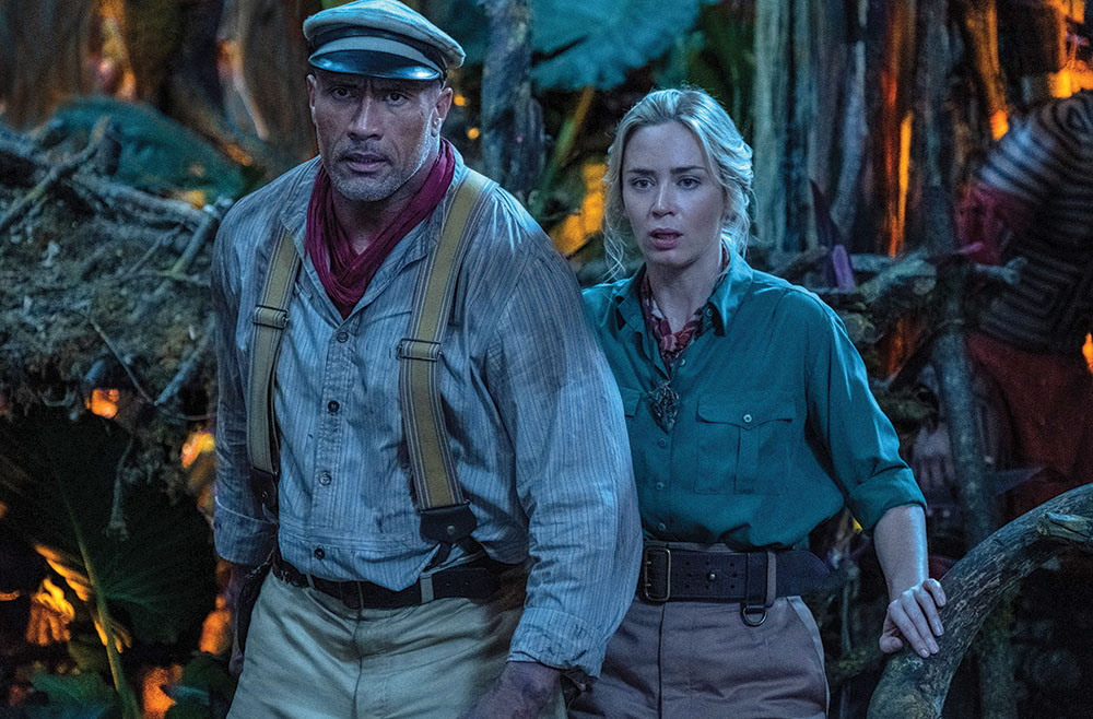 """""""He said to me once, 'I love that your debut was onstage with Dame Judi Dench and mine was in the wrestling ring cutting myself with razors,'"""" Blunt says of her Jungle Cruise co-star Johnson and their divergent career paths."""