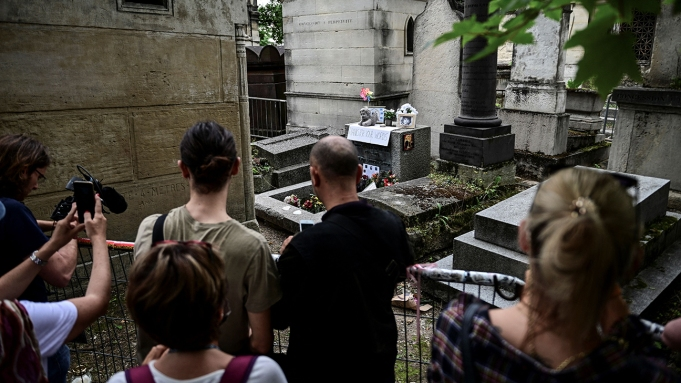 People gather by the grave of