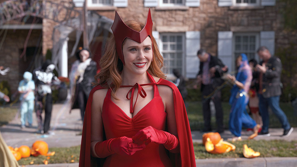 The Halloween-set episode finds Wanda donning the original Scarlet Witch costume as seen in the source-material comic books — complete with clashing pink tights.