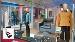 The exhibit includes costumes from every era and a restored navigation console. Inset: A communicator from the original series, on loan from the Paul G. Allen Family Foundation.